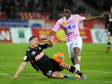 Evian's Ivory Coast's midfielder Eric Tie Bi (R) vies with Monaco's Colombian midfielder James Rodriguez during their French L1 football match Evian (ETGFC) vs Monaco (ASMFC) march 29, 2014