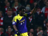 Wilfried Bony of Swansea City celebrates scoring the opening goal during the Barclays Premier League match between Arsenal and Swansea City at Emirates Stadium on March 25, 2014