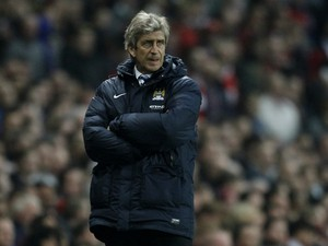 Manchester City's Chilean manager Manuel Pellegrini watches from the touchline during the English Premier League football match between Arsenal and Manchester City at the Emirates Stadium in London on March 29, 2014