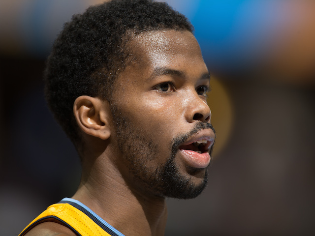 Aaron Brooks of the Denver Nuggets in action against the Brooklyn Nets at Pepsi Center on February 27, 2014