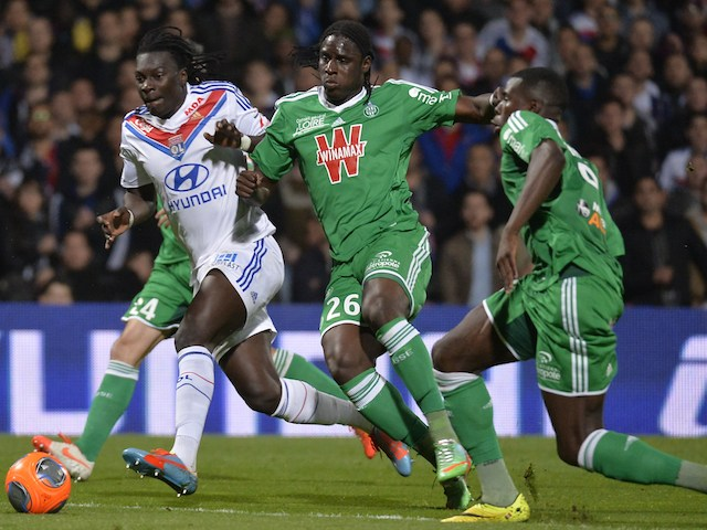 Lyon's Baf�timbi Gomis vies with St Etienne's pair Moustapha Bayal Sall and Josuha Guilavogui during the Ligue 1 match on March 30, 2014