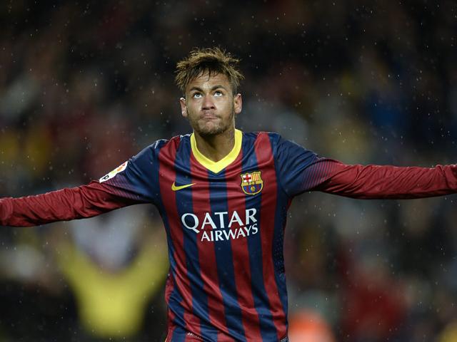 Barcelona's Brazilian forward Neymar da Silva Santos Junior celebrates after scoring during the Spanish league football match FC Barcelona vs RC Celta de Vigo at the Camp Nou stadium in Barcelona on March 26, 2014