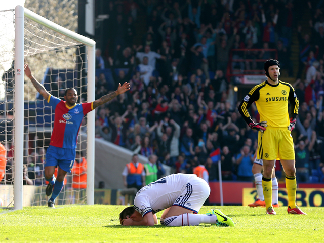 A dejected John Terry of Chelsea reacts after opening the scoring with