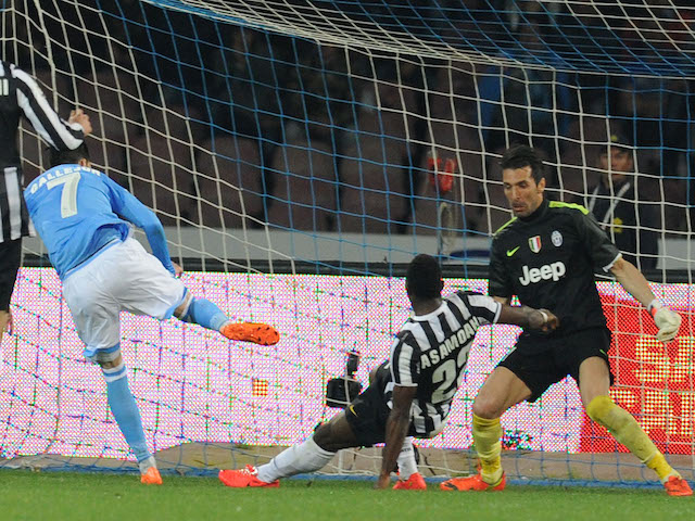 Jos� Maria Callejon of Napoli scores the opening goal during the Serie A match between SSC Napoli and Juventus at Stadio San Paolo on March 30, 2014