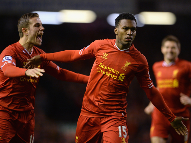 Daniel Sturridge of Liverpool celebrates scoring the second goal with team-mate Jordan Henderson during the Barclays Premier League match between Liverpool and Sunderland at Anfield on March 26, 2014