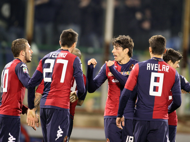 Nene of Cagliari celebrates with team-mates after scoring 1-0 during the Serie A match between Cagliari Calcio and Hellas Verona FC at Stadio Sant'Elia on March 26, 2014