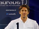 Edwin van der Sar OON poses near the Laureus logo during the Laureus Family Event held at Indoor-Sportcentrum on November 27, 2013