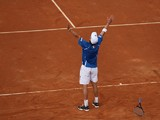 Andreas Seppi of Italy celebrates match point during the fifth and decisive rubber against James Ward of Great Britain during day three of the Davis Cup World Group Quarter Final match between Italy and Great Britain at Tennis Club Napoli on April 6, 2014