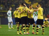 Dortmund´s players celebrate after the German first division Bundesliga football match Borussia Dortmund vs VfL Wolfsburg in Dortmund, western Germany, on April 5, 2014