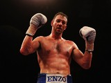 Enzo Maccarinelli celebrates triumph over opponent Carl Wild after their Light-Heavyweight bout at Wembley Arena on April 20, 2013