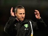 Coach Neil Adams of Norwich City celebrates victory after the FA Youth Cup Final First Leg match between Norwich City and Chelsea at Carrow Road on April 29, 2013