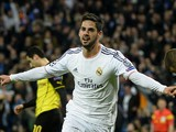 Real Madrid's midfielder Isco celebrates after scoring during the UEFA Champions League quarterfinal first leg football match Real Madrid FC vs Borussia Dortmund at the Santiago Bernabeu stadium in Madrid on April 2, 2014