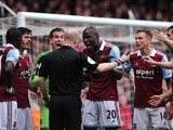 West Ham players Senegalese midfielder Mohamed Diame, English defender James Tomkins, Spanish goalkeeper Adrian, Ivorian defender Guy Demel, English midfielder Matthew Taylor and English midfielder Stewart Downing surround referee Anthony Taylor (C) to ap