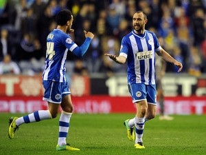Ivan Ramis (R) of Wigan Athletic is congratulated by team-mate James Perch after scoring the opening goal during the Sky Bet Championship match against Leicester City on April 1, 2014