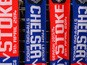 Matchday scarves are sold ahead of the Barclays Premier League match between Chelsea and Stoke City at Stamford Bridge on April 5, 2014