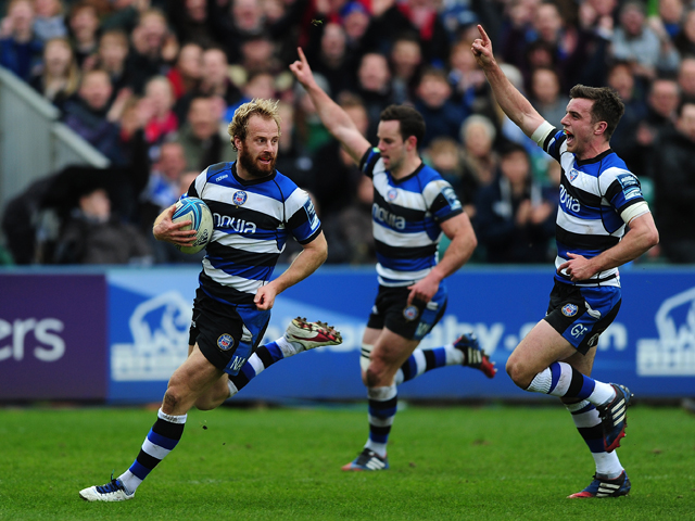 Nick Adendanon of Bath runs in for his side's second try as his team mates celebrate during the Amlin Challenge Cup quarter final match between Bath and Brive at the Recreation Ground on April 6, 2014