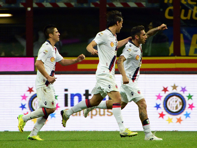 Bologna's midfielder Michele Pazienza celebrtaes after scoring during the Italian Serie A football match Inter Milan vs Bologna on April 5, 2014