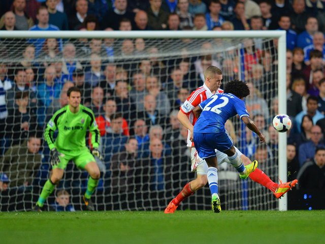 Willian of Chelsea scores their third goal during the Barclays Premier League match between Chelsea and Stoke City at Stamford Bridge on April 5, 2014