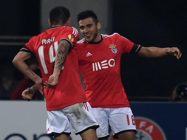 Benfica's Maxi Pereira (L) and Guilherme Siqueira celebrate after their teammate scored a goal during the UEFA Europa League Quarter final first leg football match against AZ Alkmaar on April 3, 2014