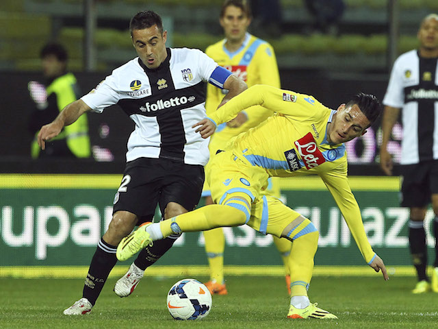 Jose Maria Callejon (R) of SSC Napoli competes for the ball with Marco Marchionni (L) of Parma FC during the Serie A match on April 6, 2014