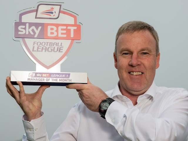 Wolves manager Kenny Jackett with his Manager of the Month award on April 3, 2014