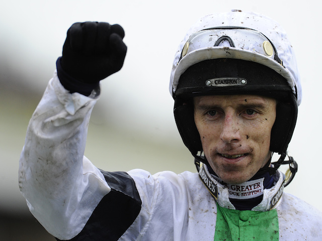 Leighton Aspell riding Pineau De Re win The Crabbie's Grand National Steeple Chase at Aintree racecourse on April 05, 2014