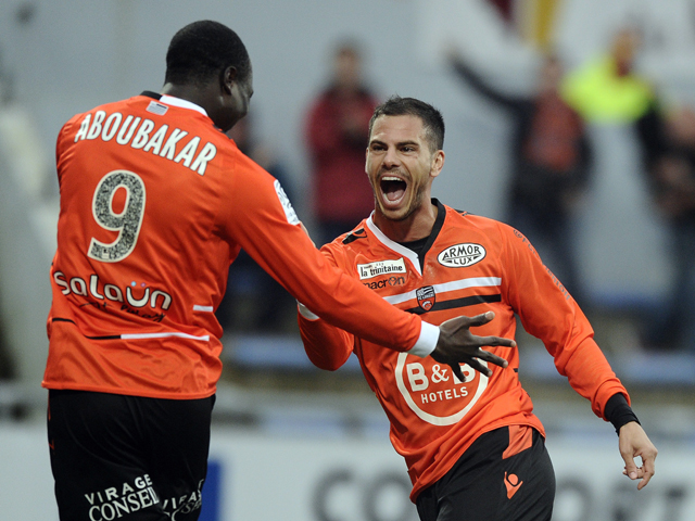 Lorient French forward Jeremie Aliadiere celebrates with his teammate Lorient's forward Vincent Aboubakar after scoring a goal during the French L1 football match between Lorient and Evian at Moustoir stadium in Lorient, western France, on April 05, 2014