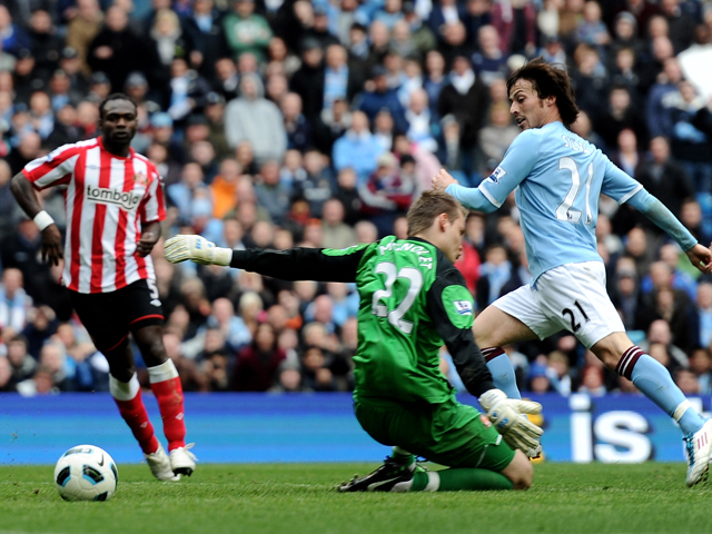 David Silva of Manchester City scores his team's third goal during the Barclays Premier League match between Manchester City and Sunderland at the City of Manchester Stadium on April 3, 2011
