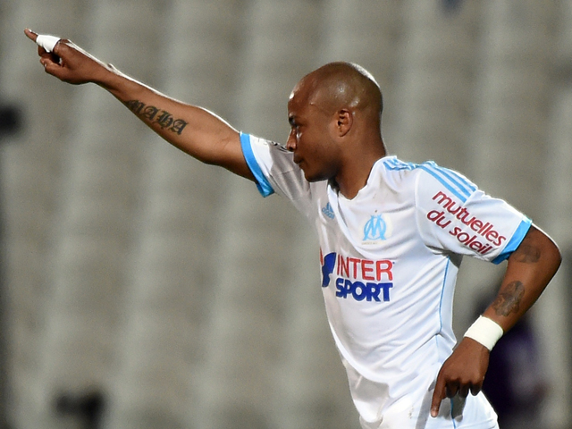 Marseille's Ghanaian forward Andre Ayew reacts after scoring a goal during the French L1 football match Marseille vs Ajaccio at the Velodrome Stadium in Marseille, southern France, on April 4, 2014