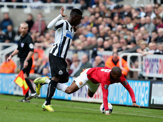 Massadio Haidara of Newcastle United and Ashley Young of Manchester United battle for the ball during the Barclays Premier League match between Newcastle United and Manchester United at St James' Park on April 5, 2014
