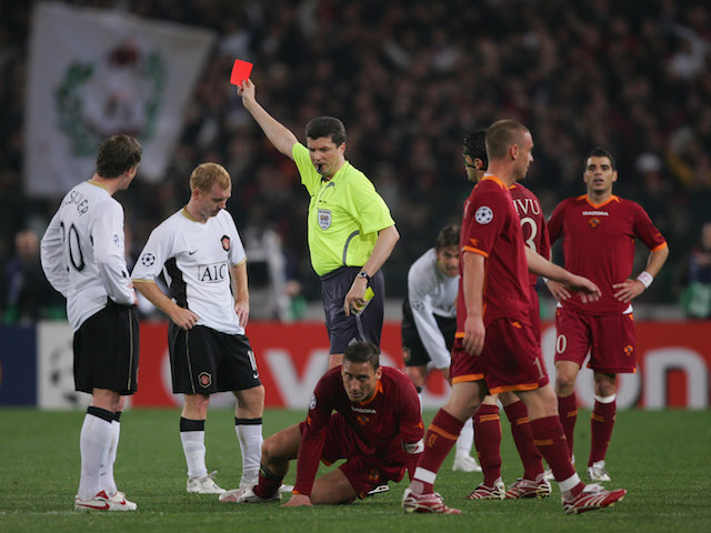 Paul Scholes of Manchester United is sent off by referee Herbert Fandel during the UEFA Champions League quarter final, first leg match against AS Roma on April 4, 2007
