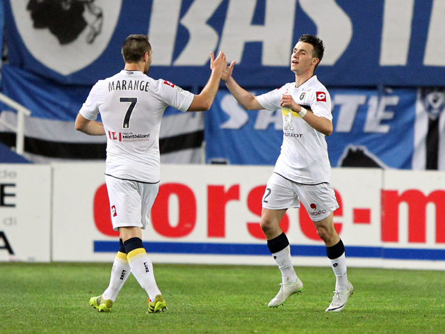 Sochaux' French defender Sebastien Corchia (R) is congratulated by teammate Florian Marange after scoring a goal during the French L1 football match Bastia (SCB) vs Sochaux (FCSM) on April 5, 2014