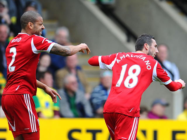 Goal scorer Morgan Amalfitano of West Bromwich Albion celebrates with Steven Reid during the Barclays Premier League match between Norwich City and West Bromwich Albion at Carrow Road on April 05, 2014