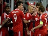 Bayern Munich's Arjen Robben celebrates with teammates after scoring his team's third goal against Manchester United in the Champions League quarter final match on April 9, 2014