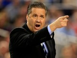 Head coach John Calipari of the Kentucky Wildcats motions to his players during the NCAA Men's Final Four Championship against the Connecticut Huskies at AT&T Stadium on April 7, 2014