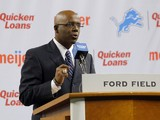 General Manager Martin Mayhew of the Detroit Lions introduces Jim Caldwell as the Lions head coach during a news conference at Ford Field on January 15, 2014