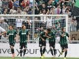 Sassuolo's Simone Zaza celebrates with team mates after scoring the opening goal against Cagliari during the Serie A match on April 12, 2014