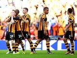 Hull's Stephen Quinn celebrates with team mates after scoring his team's fourth goal against Sheffield United during the FA Cup semi final match on April 13, 2014
