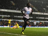 Emmanuel Adebayor of Tottenham Hotspur celebrates scoring his team's first goal during the Barclays Premier League match between Tottenham Hotspur and Sunderland at White Hart Lane on April 7, 2014