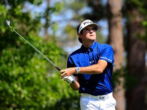 Bubba Watson of the United States in action on the fourth hole during day three of the Masters on April 12, 2014
