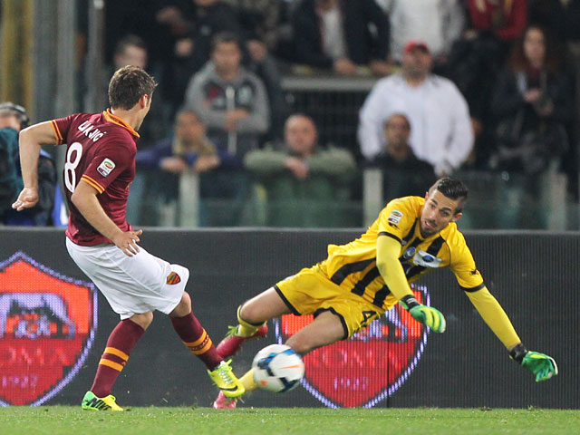 Roma's Adem Ljajic scores his team's second goal against Atalanta during the Serie A match on April 12, 2014