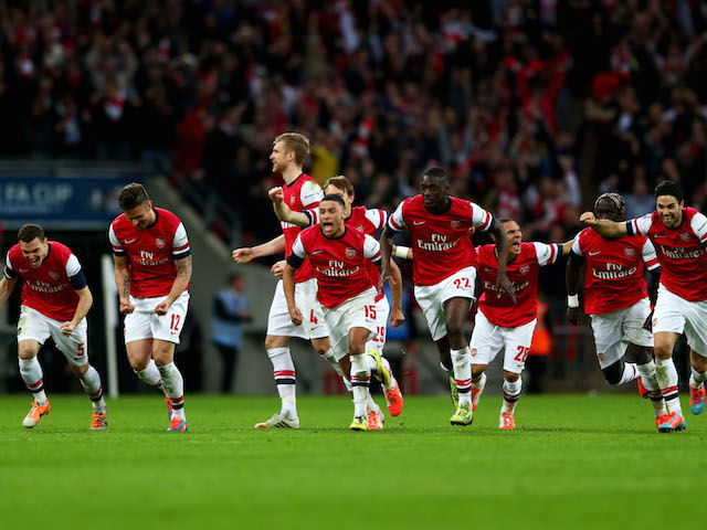 Arsenal's players celebrate after winning the FA Cup semi-final penalty shootout against Wigan Athletic at Wembley on April 12, 2014