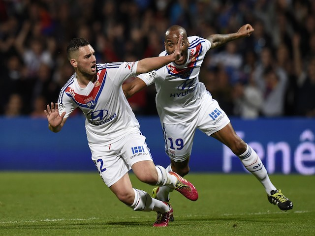Lyon's French midfielder Jordan Ferri (L) is congratuled by his teammate French forward Jimmy Briand after scoring during the French L1 football match against PSG on April 13, 2014