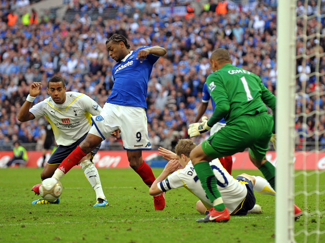 Portsmouth's French player Fredrique Piquionne scores the opening goal past Tottenham Hotspur's Brazilian goalkeeper Heurelho Gomes in extra-time of the FA Cup semi-final football match between Tottenham Hotspur and Portsmouth at Wembley Stadium, north Lo