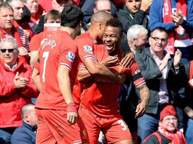 Liverpool's Raheem Sterling celebrates with team mates after scoring the opening goal against Manchester City during the Premier League match on April 13, 2014