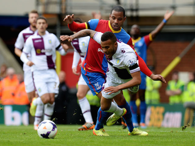 Ryan Bertrand of Aston Villa tangles with Jason Puncheon of Crystal Palace during the Barclays Premier League match on April 12, 2014