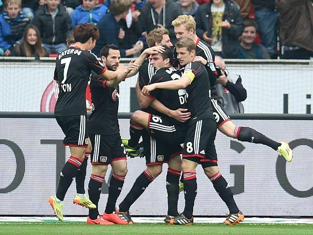 Leverkusen's Stefan Kiessling celebrates with team mates after scoring the opening goal against Hertha Berlin during the Bundesliga match on April 13, 2014