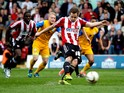 Alan Judge of Brentford scores the opening goal of the game during the Sky Bet League One match between Brentford and Preston North End at Griffin Park on April 18, 2014