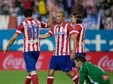 Joao Miranda of Atletico de Madrid claps his hands to celebrate scoring their opening goal with teammate Diego Costa and their teammate Filipe Luis as goalkeeper Manu Herrera of Elche FC reacts defeated during the La Liga match between Club Atletico de Ma