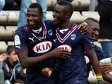 Bordeaux's Malian forward Cheick Diabate (L) celebrates with teammates after scoring a goal during the French L1 football match between FC Girondins de Bordeaux and EA Guinguamp, on April 20, 2014